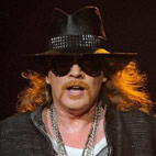 Axl Rose Falls On Stage Again