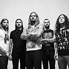 As I Lay Dying Baffle Fans With Guitar Advertisment Post