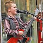 Twelve-Year-Old Busker Could Open for AC/DC After Busking Video Goes Viral
