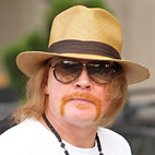 Rock Author Mick Wall Challenges Axl Rose To 'Get in the Ring'