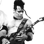 Key to Unique Guitar Sound Is in 'How You Hold Your Guitar,' Misfits' Doyle Explains