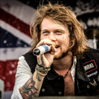 Asking Alexandria: 'We're Taking Some Time Off'