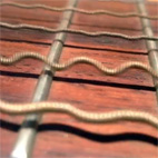 This Close-Up of Oscillating Guitar Strings is Pretty Awesome