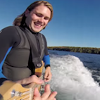 Surf Rock: Daredevil Guy Jams Guitar While Surfing