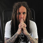 Korn Guitarist Begs For Your Money