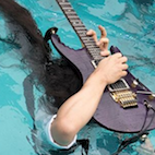 Metal as F--k: Dragonforce's Herman Li Shreds 'Through the Fire and Flames' Solo Live Underwater With Guitar Over Head