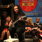 Korn's Munky Helps Deliver New Musical Instruments to California School