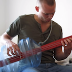 Here's a Guy Rocking Black Sabbath on Two-String Fretless Bass Made From a Water Cooler Bottle
