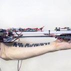 Russian Artist Invents Robot That Makes Music By Reading Tattoos
