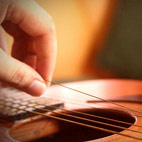 How To Change A 6 String Acoustic Guitar's Strings