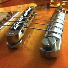 String Lock With Gibson Bridge and Individual String Height Adjustment
