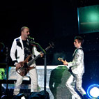 Muse Bassist 'Nearly Fainted' After Singing Live For First Time