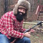 Watch: Heavily Bearded Dude Plays Guitar Built From Shotgun, Shoots From It, Plays Some More