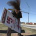 Sign Spinner Increases Pizza Shop's Profits 40% By Headbanging at Work
