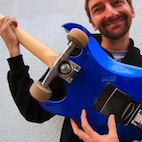 Watch: Dudes Turn Guitar Into a Skateboard, Then Smash It to Bits