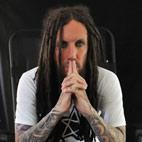 Korn Guitarist Begs For Your Money