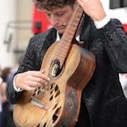 Watch: Street Guitarist Pulls Out Severely Broken and Beaten Guitar, Delivers Mind-Blowing Performance