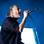 Chili Peppers' Flea Teaching Thom Yorke To Surf?