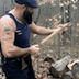 Watch: Heavily Bearded Dude Jams on Guitar Made From Axe, Chops Wood With It, Plays Some More